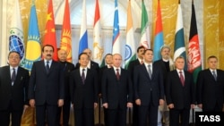 Russia -- Participants pose for a photo at a meeting of the Shanghai Cooperation Organisation in St. Petersburg, 07Nov2011