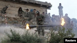 File photo of the Afghan National Army fighting insurgents in Nuristan.