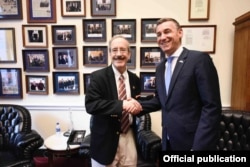 Kosovo's then-speaker of parliament, Kadri Veseli, meets in Washington with Eliot Engel in 2019.