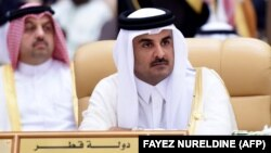 Qatar's Emir Sheikh Tamim bin Hamad al-Thani attends the 4th Summit of Arab States and South American countries on November 11, 2015.