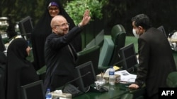 Mohammad Bagher Qalibaf greets members of the parliament after being elected as parliament speaker at the Iranian parliament in Tehran, May 28, 2020