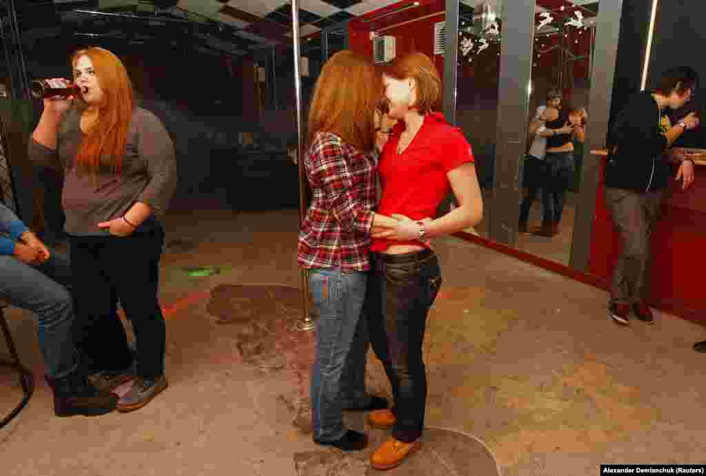 "Women at a private gay club in St. Petersburg in 2013. A survey taken in 2013 showed 74 percent of Russians thought homosexuality was unacceptable in society, with a further 5 percent saying gays should be ""liquidated."""