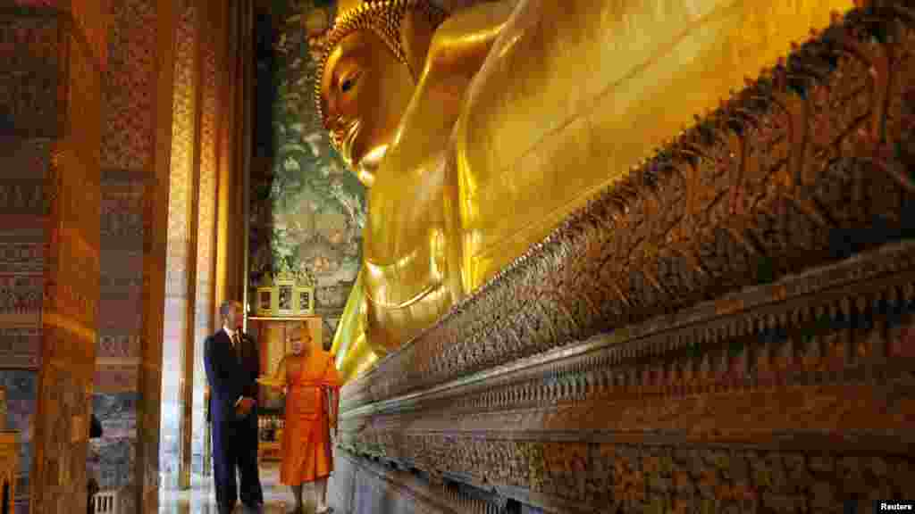 U.S. President Barack Obama tours the reclining Buddha at the Wat Pho Royal Monastery in Bangkok, Thailand. Obama was on a three-country Asia tour, using his first postelection trek overseas to try to show he is serious about shifting the U.S. strategic focus eastward. (Reuters/Jason Reed)