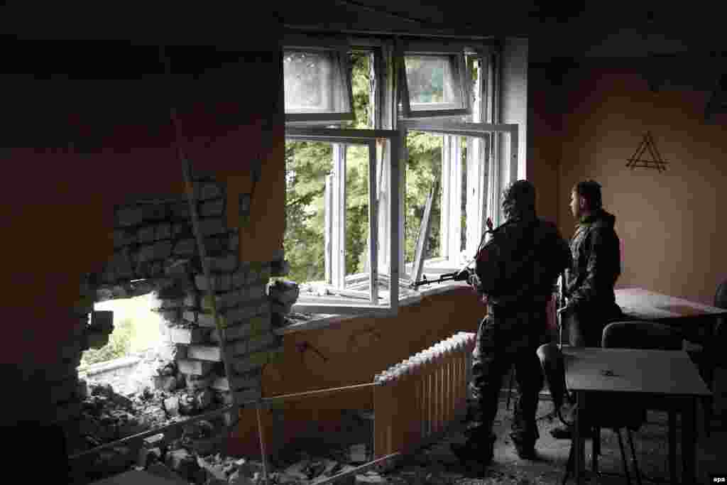 Pro-Russian militants shelter inside a psychiatric hospital during fighting with the Ukrainian Army, in Semyonovka village, outside Slovyansk.