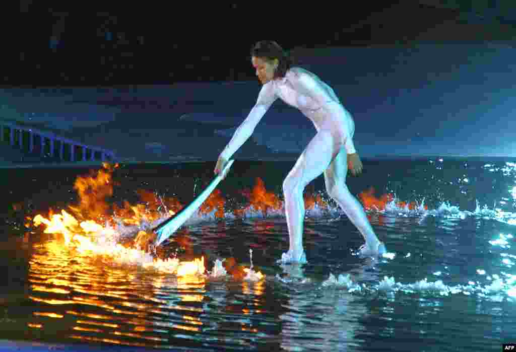 Australian aborigine athlete Cathy Freeman lights the Olympic cauldron in Sydney in September 2000.
