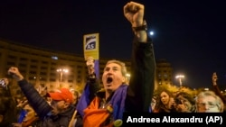 "Antigovernment protesters shout ""Democracy is under siege"" in Bucharest on November 5."