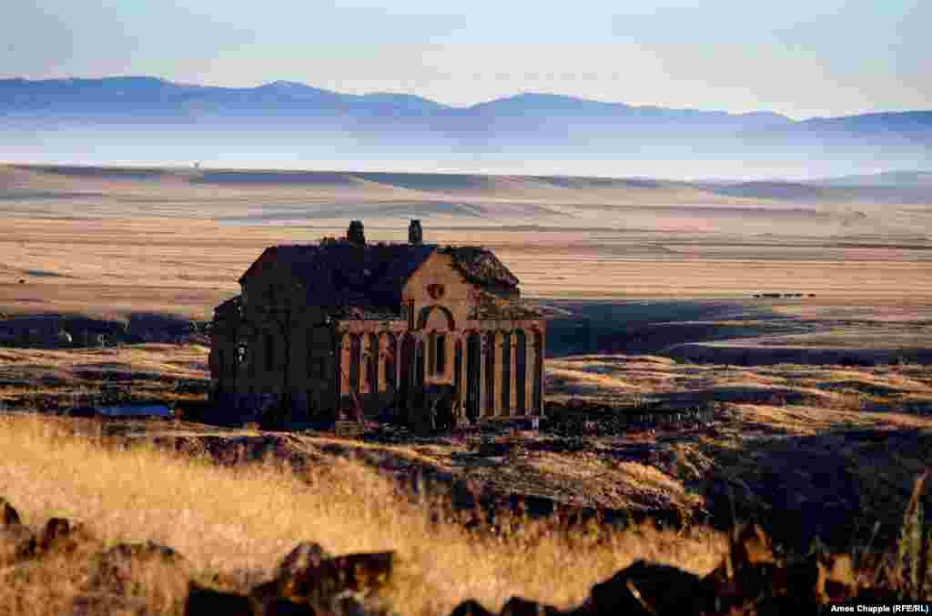 Sun-scorched plains and the ruins of Ani Cathedral. A complex tug-of-war since its founding more than a millennium ago saw Ani variously controlled by Russia, the Ottoman Empire, and Armenia before finally being captured by the newly formed Turkish Republic in 1920. Ani was abandoned centuries ago, but it is treasured by Armenians today as a symbol of former splendor.