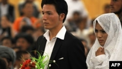 "The families of many Afghan brides demand that the groom spend thousands of dollars in ""walwar"" payments and other gifts. The groom is also required to pay for a lavish wedding banquet and a string of wedding-related parties. (file photo)"