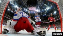 Canada's Ennis Tyler scores against Russia during the ice hockey world championship game in Prague on May 17.