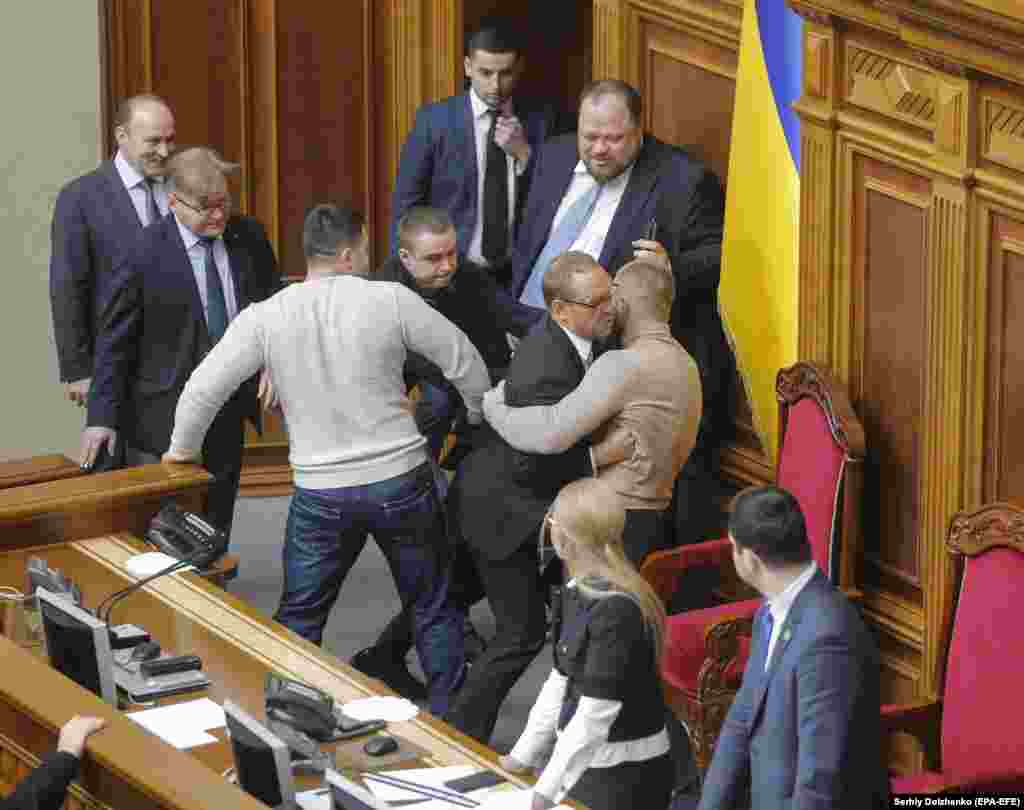 Ukrainian lawmakers clash in Kyiv as they try to block the podium during a hearing to change the laws on the sale of farmland. A moratorium on the sale of farmland has been in place in Ukraine, considered to possess one of Europe's richest soils, for some 20 years, and liberating the land market has triggered fears that fertile Ukrainian soil could be bought up by foreign investors. (epa-EFE/Sergei Dolzhenko)