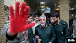 Qassem Suleimani (center), head of the Islamic Revolutionary Guards Corps' Quds Force, attends a remembrance ceremony for fallen Quds Force troops in Iran in October.