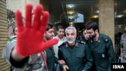 The commander of Iran's powerful Qods Force, Qassem Suleimani (center), attends a remembrance ceremony for martyrs from that branch of the Islamic Revolutionary Guards Corps, in Iran on Oct 20.