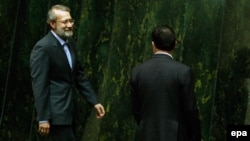 Ali Larijani makes his way to the podium after being elected as interim parliament speaker in Tehran on May 29.
