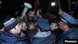 Armenia - Opposition leader Zhirayr Sefilian appeals to riot police as they clash with protesters in Yerevan, 1Dec2015.