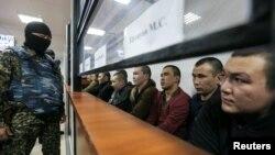 Обвиняемые по делу о вооруженных нападениях 5 июня в суде. Актобе, 28 ноября 2016 года.