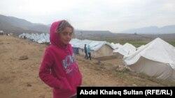 Дівчинка у таборі біженців, що втекли внаслідок наступу бойовиків «Ісламської держави» в Іраку