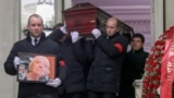 Pallbearers carry the late activist Lyudmila Alekseyeva's coffin after a mourning ceremony in Moscow on December 11.