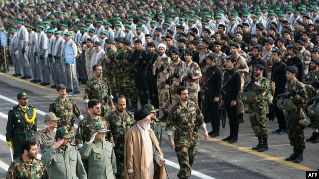 Iranian Supreme Leader Ayatollah Ali Khamenei (center) walks with Iranian commanders past Basij militia ranks in Tehran. (file photo)