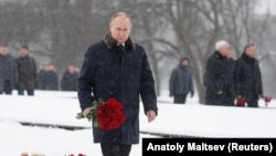 Russian President Vladimir Putin lays flowers during a ceremony to mark the 75th anniversary of the Soviet breakthrough in the Nazi Siege of Leningrad in World War II, in St. Petersburg on January 18.