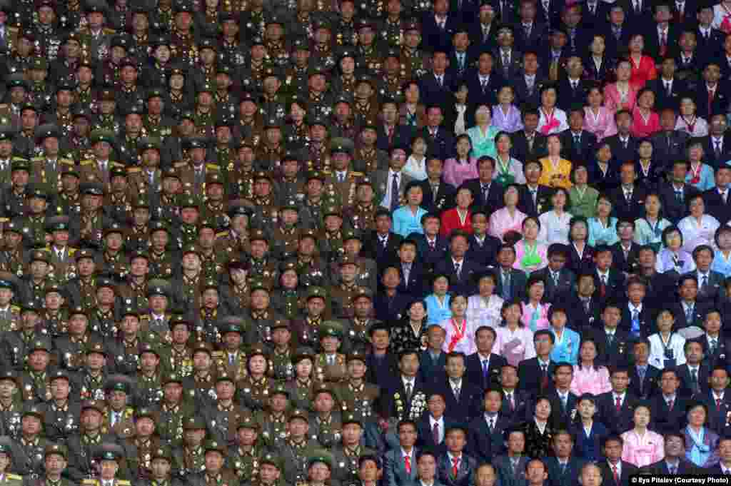 Photographer Ilya Pitalev of Russia was selected in the Current Affairs category for this shot taken during the celebrations of the 100th anniversary of the birth of North Korea founder Kim Il Sung in Pyongyang in April 2012.