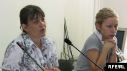 Marika Tsotsoria, left, and Natalia Parfenova, wives of arrested Kazatomprom executives at a press conference on July 1