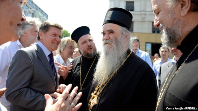 At a rally in Belgrade on May 10 against a normalization deal between Serbia and Kosovo, Bishop Atanasije (second from right) compared Prime Minister Ivica Dacic to former Prime Minister Zoran Djindjic, who was assassinated in 2003.