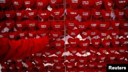 A vendor in the central Bosnian town of Zenica sells heart-shaped cushions with proclamations of love for 1 euro each.