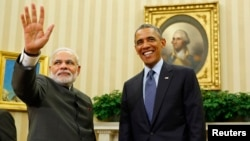 U.S. President Barack Obama (left) hosts a meeting with Indian Prime Minister Narendra Modi in Washington last year.