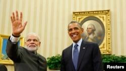 Barack Obama (sağda) və Narendra Modi (arxiv fotosu)