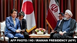 President Hassan Rouhani meeting with Japanese Prime Minister Shinzo Abe on the sidelines of the 74th United Nations General Assembly in New York. (Photo by - / Iranian Presidency / AFP). President Rouhani is to visit Japan later this week.