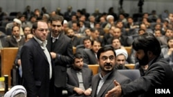 Tehran's former prosecutor, Said Mortazavi (center), may be exiting the scene. What does his apparent downfall tell us about the country's political landscape and the ongoing trial of strength between the president and his pragmatic conservative critics?