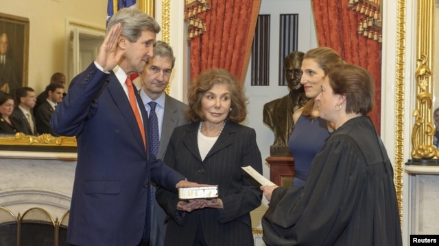John Kerry (left) is officially sworn in as secretary of state in Washington on February 1.