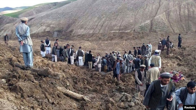 Afghan villagers gather at the site of the deadly landslide.