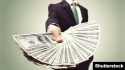 Generic – Business Man Displaying a Spread of Cash over a green vintage.