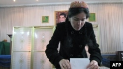 A woman casts her ballot at a polling station in Ashgabat.