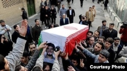 People take part in the funeral in Tehran of Sanee Zhaleh, a student who was shot dead during an opposition rally on February 14.