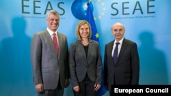 Kosovar Prime Minister Isa Mustafa (right), Kosovar President Hashim Thaci (l) and European Union foreign policy chief Federica Mogherini attend talks on establishing normal relations between Serbia and Kosovo in Brussels on January 24.
