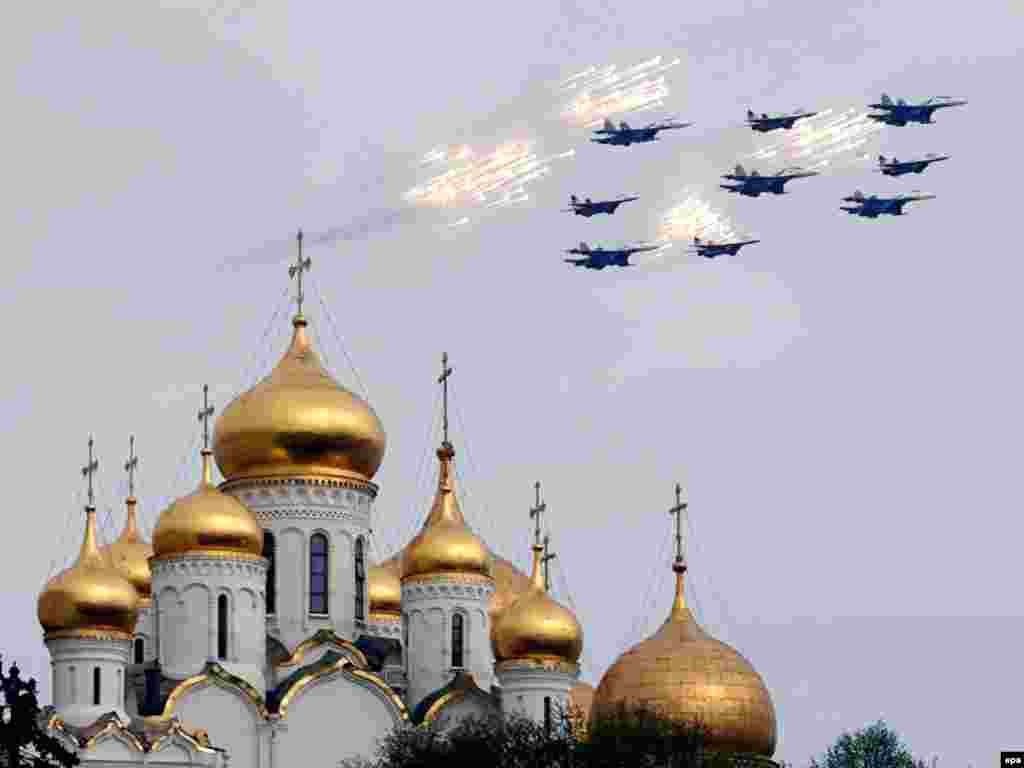 Military airplanes fly in formation over Moscow as Russia prepares to celebrate the 65th anniversary of the defeat of Nazi Germany on May 9. Photo by Maxim Shipenkov for epa