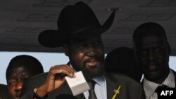 Southern Sudan leader Salva Kiir casts his vote at a polling station in Juba.