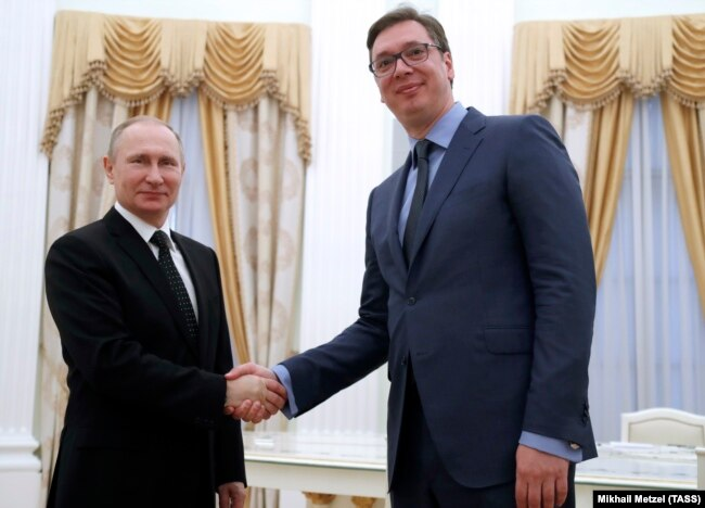 Russian President Vladimir Putin (left) meets with Serbian Prime Minister Aleksandar Vucic at the Kremlin in Moscow on March 27.