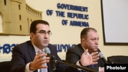 Armenia - Deputy Ministers of Economy Garegin Melkonian and Tigran Harutyunian give a press conference in Yerevan, 18Feb2014.