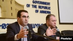 Armenia - Deputy Minister of Economy Garegin Melkonian (L) speaks at a press conference in Yerevan, 18Feb2014.