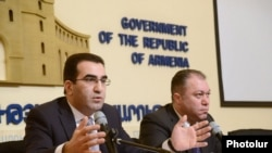Armenia - Deputy Minister of Economy Garegin Melkonian (L) at a press conference in Yerevan, 18Feb2014.