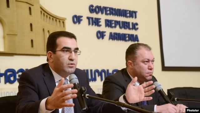 Armenia - Deputy Ministers of Economy Garegin Melkonian and Tigran Harutyunian give a press conference in Yerevan, 18Feb2014.