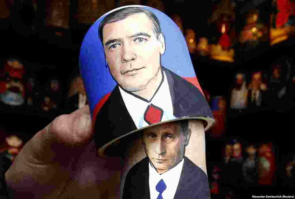 A matryoshka or Russian nesting doll at a market in St. Petersburg shows Putin lurking behind Medvedev.