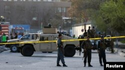 Afghan policemen seal off the site of a suicide bombing in Kabul on April 12.