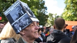 "Yury Sternik takes part in a protest against pension reform at Sverdlovsk Park in St. Petersburg on September 16, complete with his ""Sternik hat."""