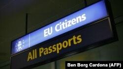Malta - An immigration sign at Malta International Airport, 4Dec2007.