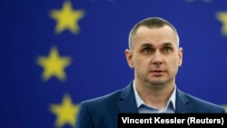 Oleh Sentsov delivers his speech during the award ceremony for the Sakharov Prize at the European Parliament in Strasbourg on November 26.