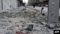 Blood and debris on a sidewalk following a mortar attack in the northern Syrian city of Aleppo on November 6.